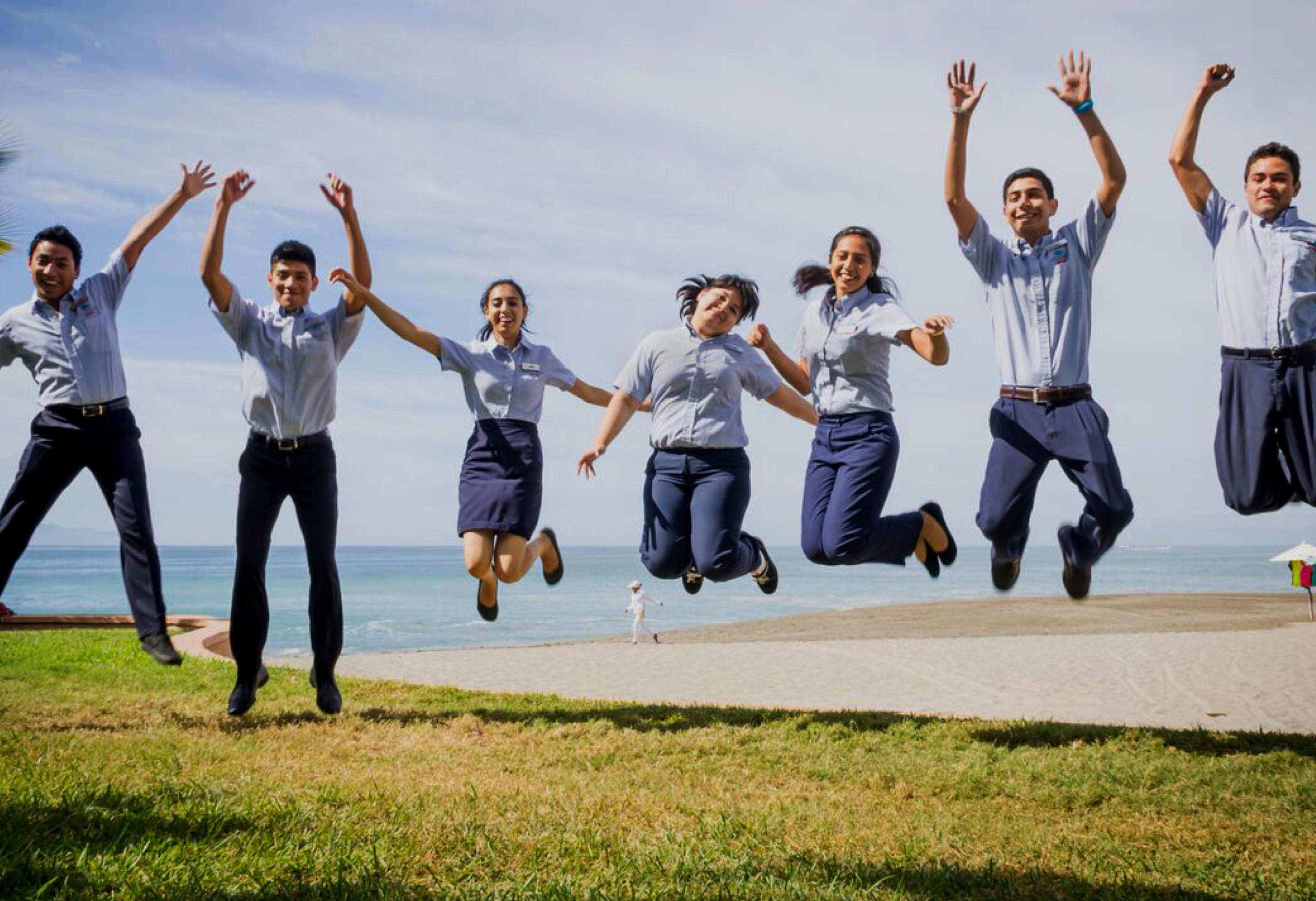 Employees jumping up in unison