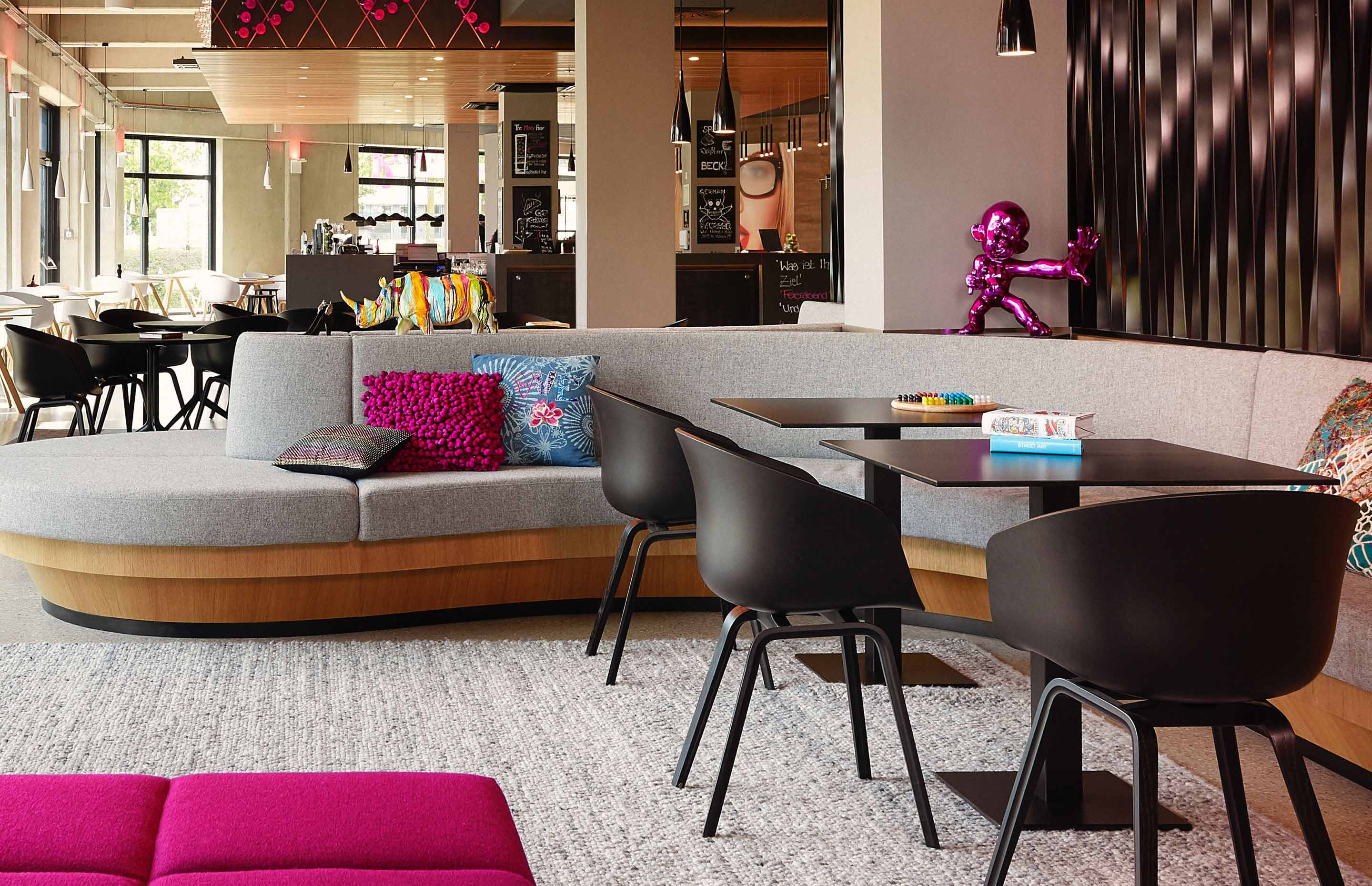 A sleek lobby at a Moxy Hotel