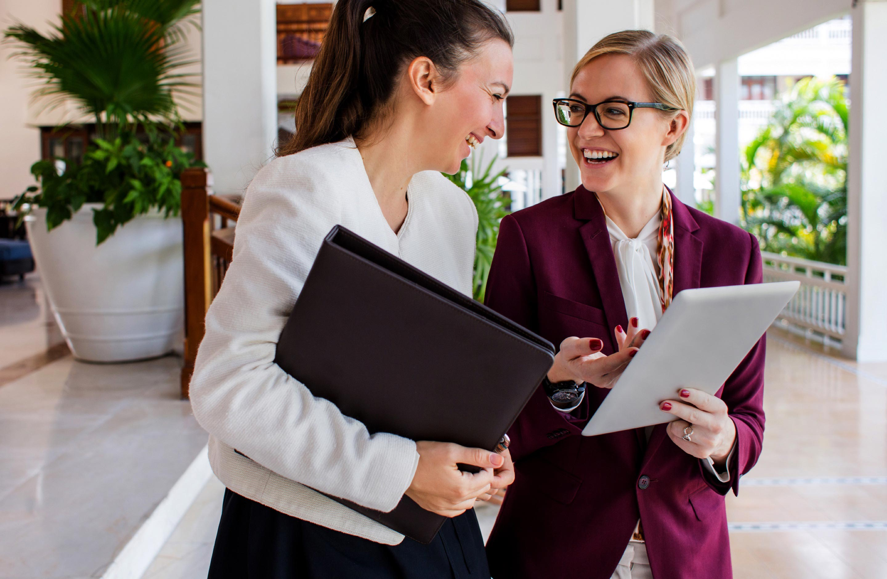 Two business women smiling at each other